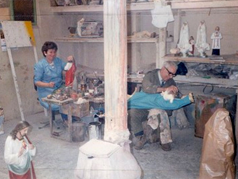 Religious statues being painted in workshop